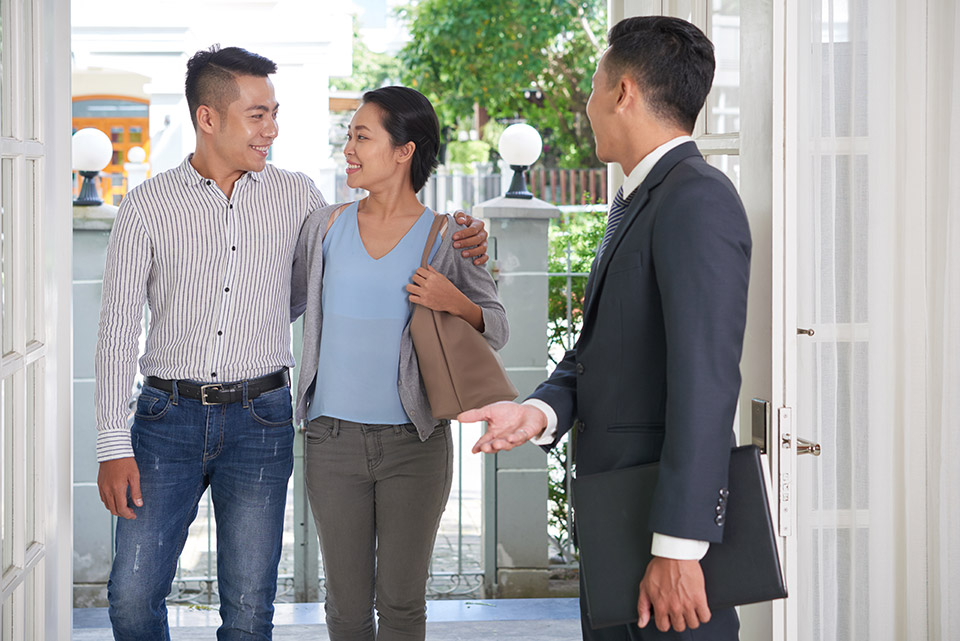 estate agent showing potential buyers around